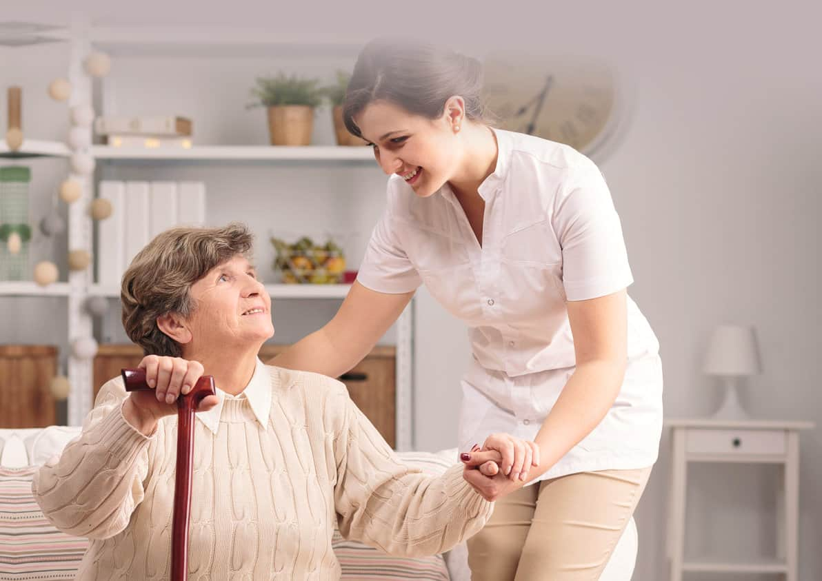 caregiver helping a senior woman